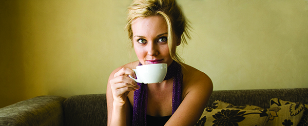 Blonde_female_sipping_coffee